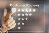 stock photo of reaction  - business hand clicking customer reviews on virtual screen interface - JPG