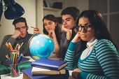 pic of geography  - A beautiful girl students of Geography sitting and looking at camera in the foreground - JPG