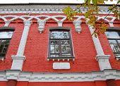 picture of rabbi  - architecture a fragment of an old brick house with Jewish symbols red - JPG