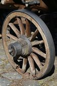 image of paved road  - A wooden wheel is on a paved road - JPG