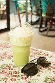 stock photo of frappe  - Glass of green tea latte frappe stock photo - JPG