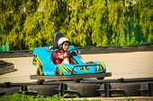 picture of karts  - Cute Thai girl is driving Go - JPG