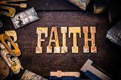 image of faithfulness  - The word faith written in rusted metal letters surrounded by vintage wooden and metal letterpress type. ** Note: Visible grain at 100%, best at smaller sizes - JPG