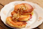 foto of cheesecake  - cheesecakes with sauce from pears on an old plate - JPG