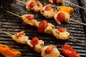 picture of grill  - Grilled Parmesan crust shrimp with chery tomatoes on the grill with grilled mini bell peppers - JPG