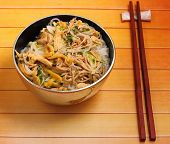 image of rice noodles  - Vietnamese vermicelli chicken and rice noodles soup pho on a wood table top - JPG