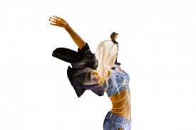 stock photo of inverted  - young woman in motion with arms up - JPG