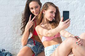 image of v-day  - Female friends taking self - JPG