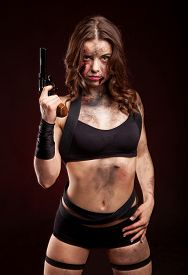 picture of girls guns  - Beautiful sexy girl with gun. Posing in studio. With blood on face and wound. ** Note: Soft Focus at 100%, best at smaller sizes - JPG