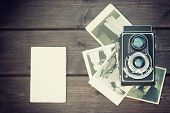 Постер, плакат: Vintage Photo Of Old Camera And Old Photos