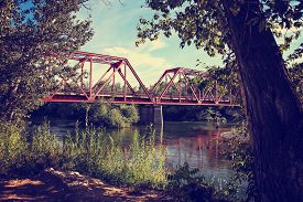 picture of trestle bridge  -  a beautiful park river and a train trestle bridge toned with a retro vintage instagram filter effect app or action - JPG
