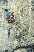 Rock Climber Ascending A Challenging Cliff. Extreme Sport Climbing. Freedom, Risk, Challenge, Succes poster