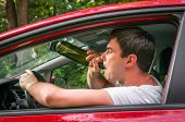 Drunk Driver With Bottle Of Wine Driving A Car poster