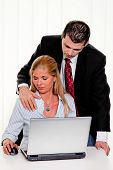 stock photo of groping  - Sexual harassment of women at work in the office - JPG