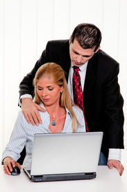 image of groping  - Sexual harassment of women at work in the office - JPG