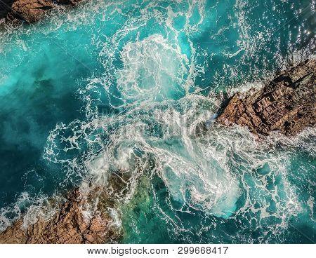 poster of Beautiful aerial birds eye view on ocean waves, Fuerteventura island. Aerial shooting seascape coast