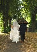 Bride And Groom Walking Away poster