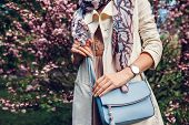Young Woman Holding Stylish Handbag And Wearing Trendy Outfit. Spring Female Clothes And Accessories poster