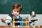 Lab Microscope And Testing Tubes. Little Kid Scientist Earning Chemistry In School Lab. Child In The poster