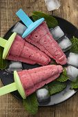 Summer Icecream. Homemade Berry Popsicles On A Rustic Wood Background. Fresh Strawberry Lolly Icecre poster