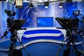 stock photo of production  - TV studio with camera and lights  - JPG