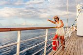 Happy cruise vacation fun travel woman pointing watching whales or wildlife sighting from deck of bo poster