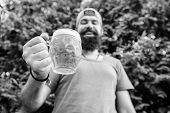 Cheers Concept. Distinct Beer Culture. Hipster Brutal Bearded Man Hold Mug Cold Fresh Beer. Man Rela poster