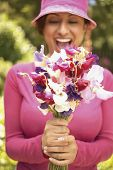 picture of sweetpea  - Woman holding flowers - JPG