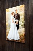 Photo Of A Wedding Couple Printed On Canvas. Photography Stretched On A Frame Hanging On A Brown Woo poster