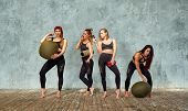 A Group Of Beautiful Fitness Girls In A Fitness Room Near A Gray Wall With A Props For Training, Emo poster