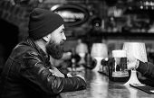 Man With Beard Spend Leisure In Dark Bar. Brutal Lonely Hipster. Brutal Hipster Bearded Man Sit At B poster