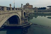 Aurelius Bridge Over Tiber River In The Historic Center Of Rome With Side View Of Castle Sant Angelo poster