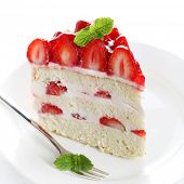 stock photo of cream cake  - piece of cake on white plate with strawberries - JPG