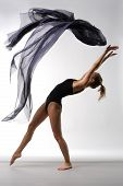 pic of ballet dancer  - young beautiful ballerina posing on grey background - JPG