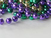 stock photo of mardi-gras  - close up photo of mardi gras beads with room for text - JPG