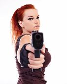 pic of raider  - Beautiful redhead young woman with gun holster and military outfit isolated on white background - JPG