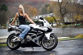 picture of crotch-rocket  - A pretty blonde girl posing on a motorcycle - JPG