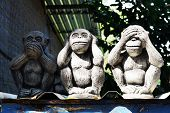 stock photo of sita  - Monkey statue hand eye ear mouth in the country of thailand - JPG