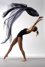 image of ballet dancer  - young beautiful ballerina posing on grey background - JPG