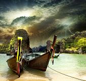 Traditional Thai boat on the shore of the Andaman Sea. TPhiphi island. monsoon