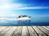 stock photo of life-boat  - speed boat in tropical sea - JPG