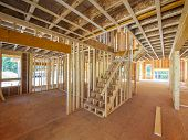 stock photo of roofs  - Interior framing of a new house under construction - JPG