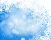 Abstract blue and white christmas background with snowflakes