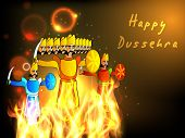 Indian festival Happy Dussehra background with statue of Ravana, Meghnath and Kumbhkaran in fire.