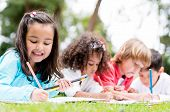 stock photo of nursery school child  - Happy group of school kids having fun - JPG