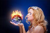 foto of hemisphere  - Frozen girl holding burning earth globe  - JPG