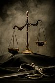 stock photo of mantle  - Scales and Sword of Justice on a judge - JPG