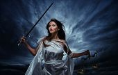Постер, плакат: Femida Goddess of Justice with scales and sword against dramatic stormy sky