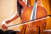 stock photo of cello  - Detail of a woman playing a cello - JPG