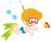 image of fish skin  - Boy diving with a mask and snorkel among funny fishes - JPG